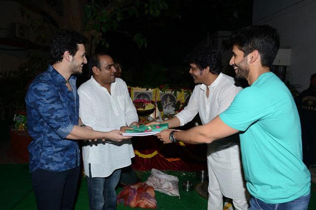 Nagarjuna and Naga Chaitanya handing over the script to Akhil and Vikram K Kumar
