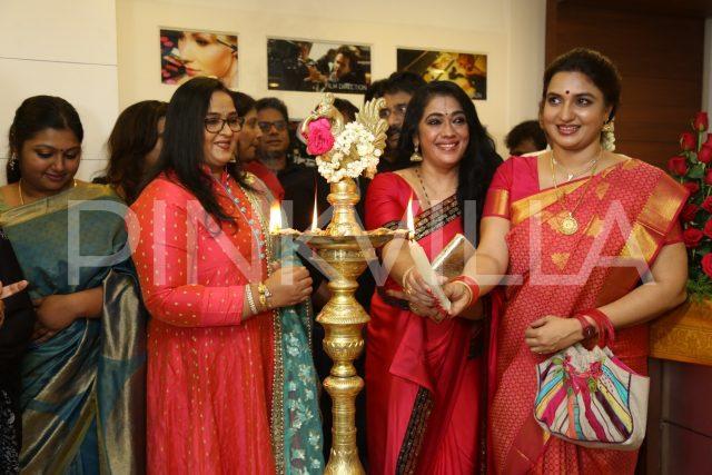 Actresses Radha and Sukanya lighting the lamp