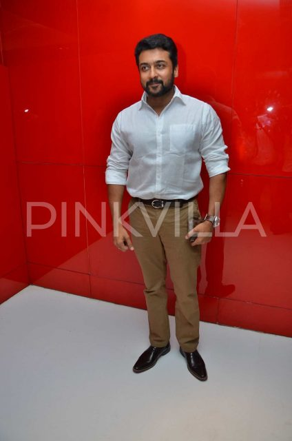 Suriya posing for the cameras