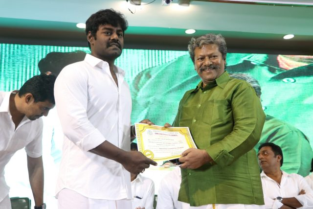 Rajkiran giving away the certificates