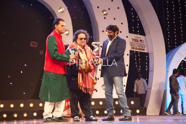 T Subbirami Reddy and Balakrishna present the award to Bappi Lahiri