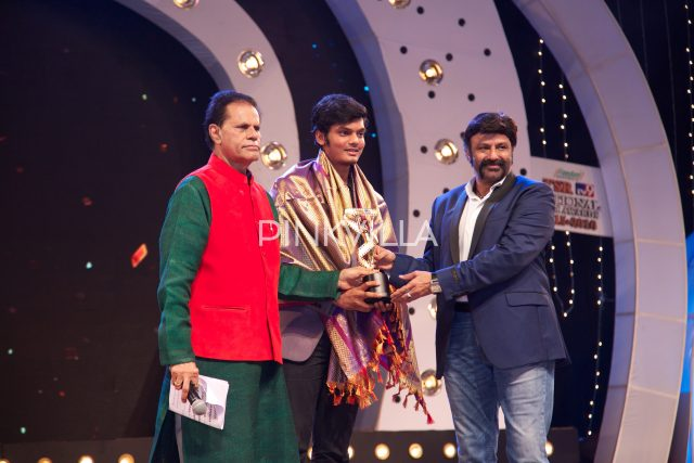 T Subbirami Reddy and Balakrishna present the award to Puri Akash