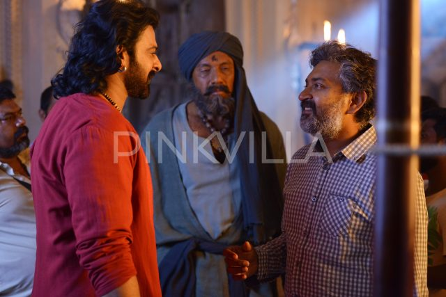 Prabhas and Rajamouli in conversation while Sathyaraj looks on