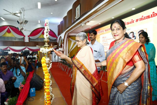 Vishal's mother lighting the lamp