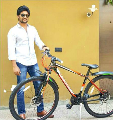 Nani with the bicycle gifted by Chiranjeevi
