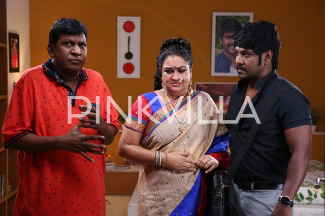 Vadivelu, Urvashi and Lawrence in a scene from Sivalinga