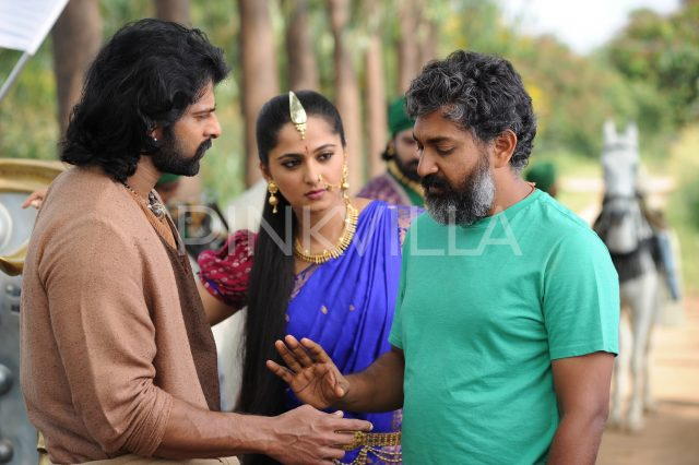 Anushka Shetty looks on as Rajamouli and Prabhas are in discussion