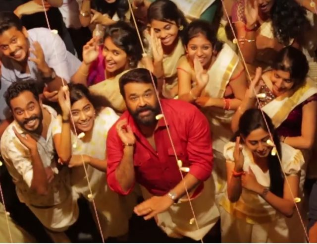 Watch: Mohanlal shakes a leg for the famous 'Jimikki Kammal' song in his own style along with the team of Velipadinte Pusthakam