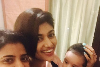 Photo: A lovely Aishwarya Rajesh and a lively Oviya strike a pose with the 'Dhruva Natchathiram' star's nephew