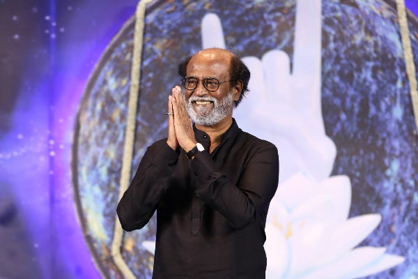 We don't need to fall at the feet of people in power, Rajinikanth tells his fans