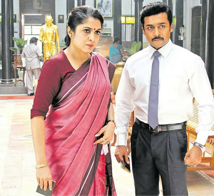 A dashing Suriya and an elegant Ramya Krishnan look awesome in this still from Thaanaa Serndha Koottam