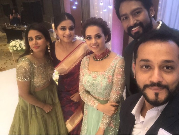 Bhavana strikes a pose with Priyamani and Parul Yadav at her reception