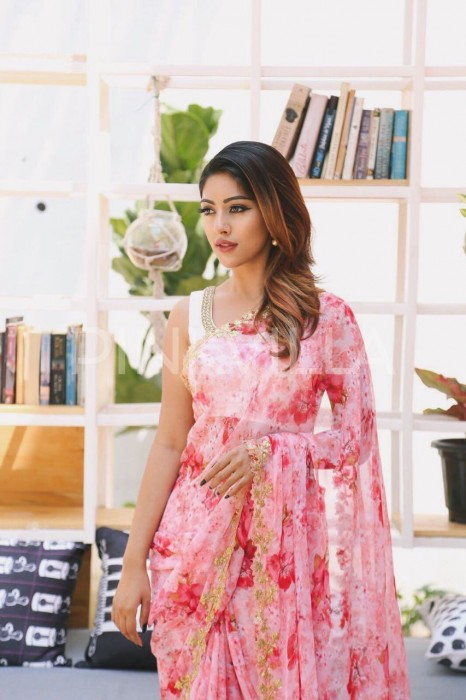 Anu Emmanuel donned a pastel pink and red printed floral chiffon saree by Ashwini Reddy which also had a golden leaf motif border.