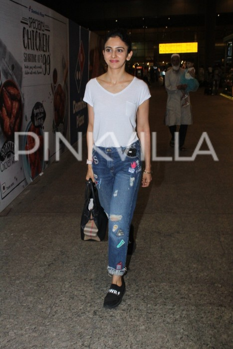 Rakul wore ripped badges jeans paired with simple white tee