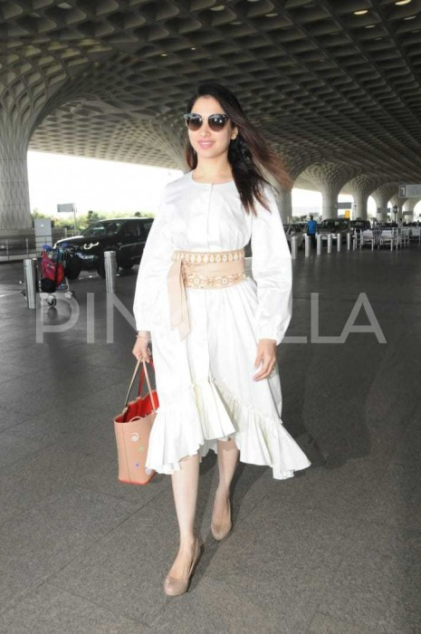 Photos: Tamannaah Bhatia keeps it simple in white as she makes a splash at the airport