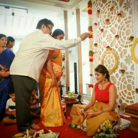Meghana's parents clicked as they perform Haldi ceremony rituals