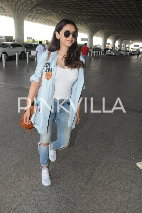 Aditi Rao Hydari clicked wearing cheeky shirt, a white tank top paired with knee-ripped denim