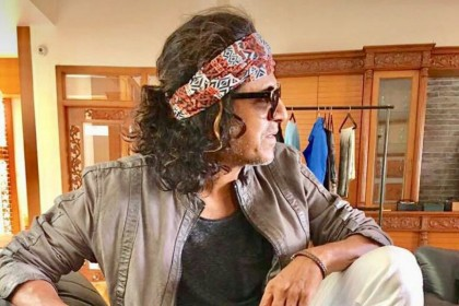 See Pic: Shivarajkumar's funky look from his upcoming film The Villain goes viral
