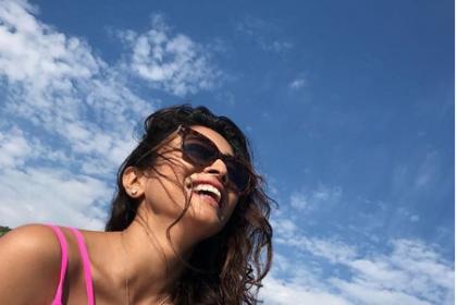 Photos: Shriya Saran sizzles in a hot pink bikini